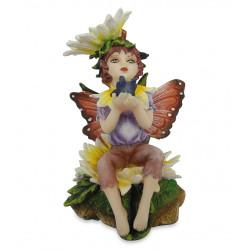 Fatina seduta con fiore...